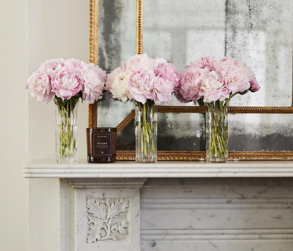 three bunches of pink peonies in baccarat crystal vases