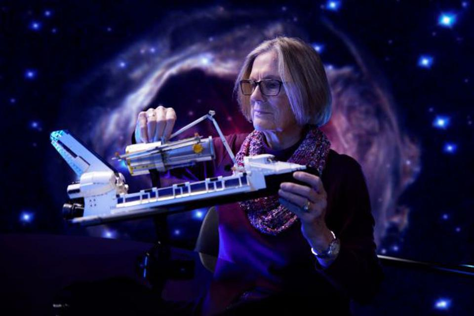 First female American astronaut to walk on the moon, Kathy Sullivan holds LEGO Model