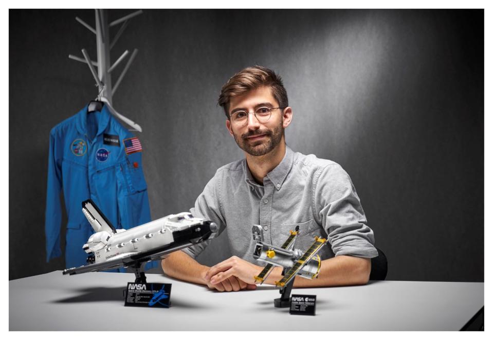 LEGO designer holding NASA models