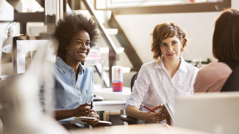 Happy businesswomen in office