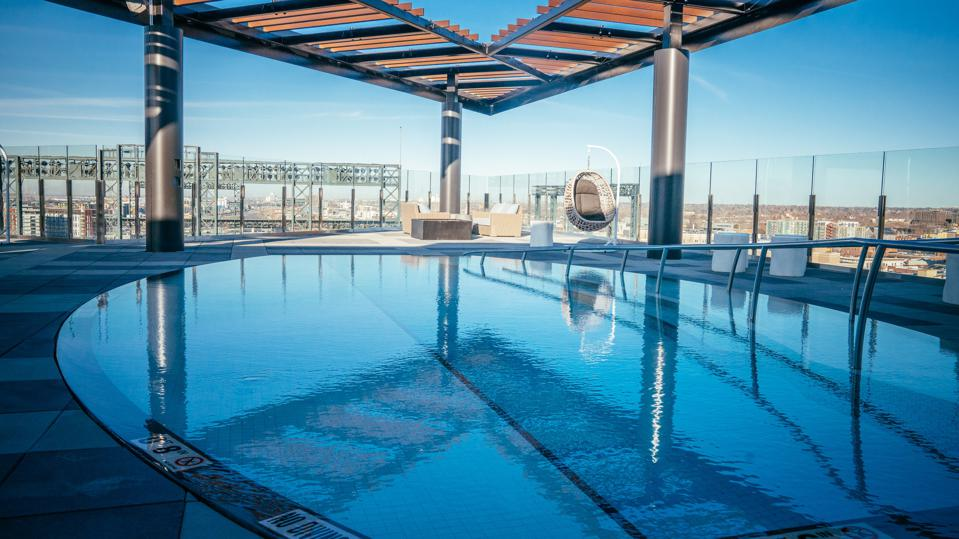 A rooftop pool and Denver skyline.