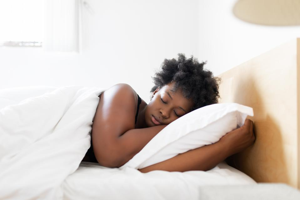 Woman sleeping in her bed at home