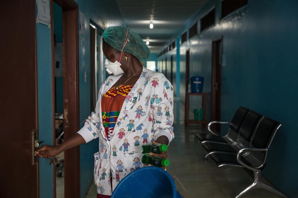 A nurse seen entering a ward for tuberculosis patients.