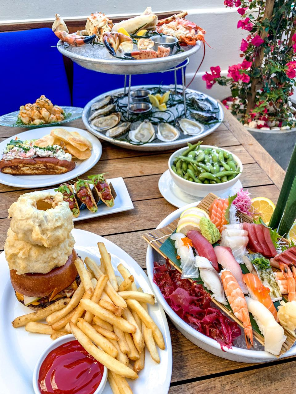 a spread of sushi and seafood
