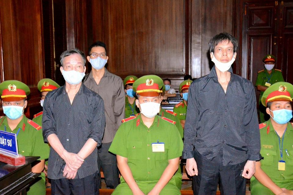 Vietnamese blogger Pham Chi Dung (right) during his trial in 2021.