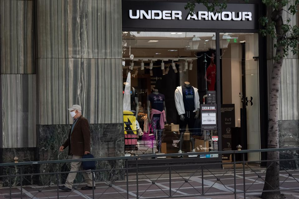 A man walking past the Under Armour store at Syntagma square...