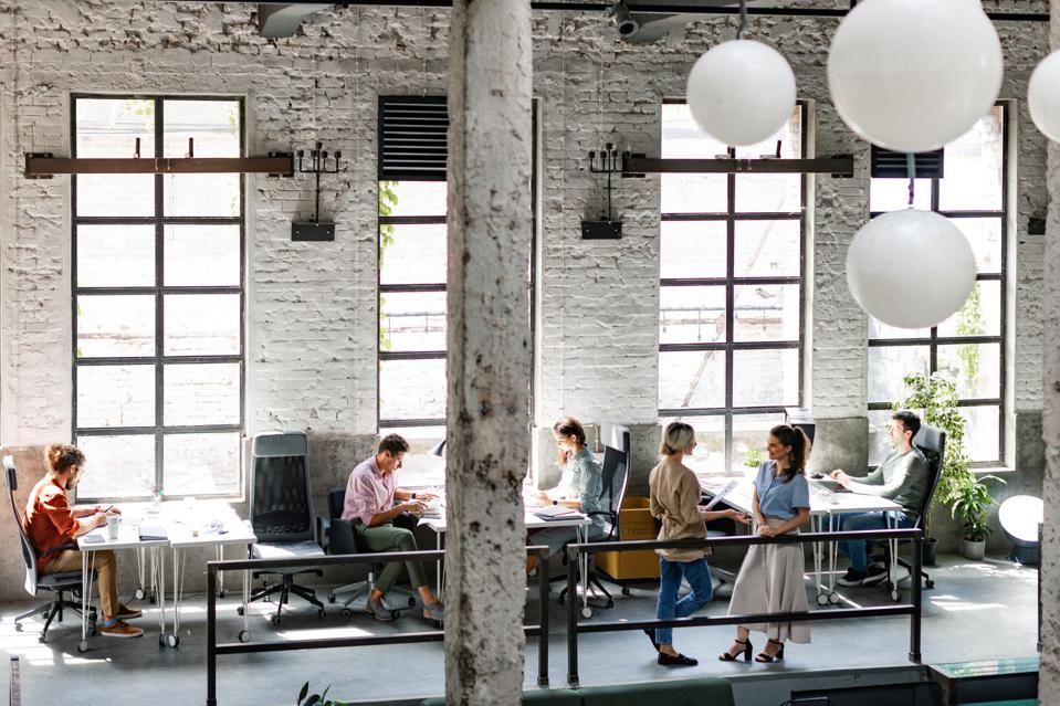 Modern Companies:  Group of Young Business People at a Spacious Loft Open Space Coworking Office Working Together