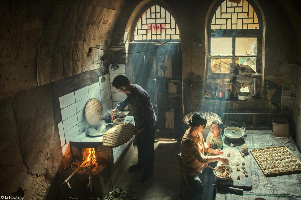 vFood Photo cmpetition:  a young family sharing in the joy of preparing food.