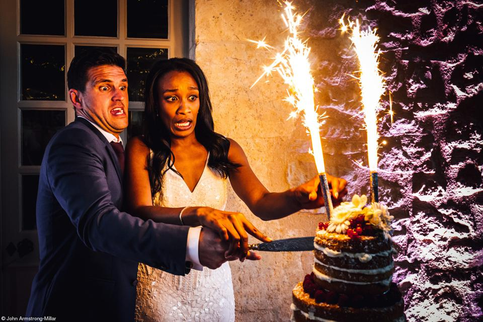 Food Photo competition: wedding couple facing  a cake in fire.