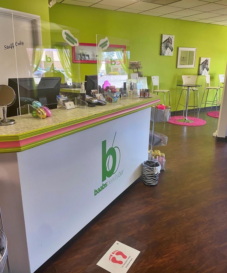 Hair salon with green walls and pink shadows