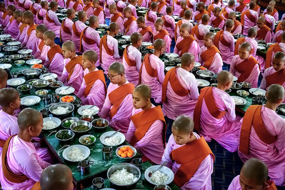 Food Photo competition, Buddhist nuns pray before a meal at a nunnery in Sagaing, Myanmar.