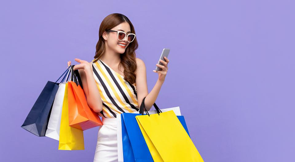 Woman Shopping With Mobile Phone