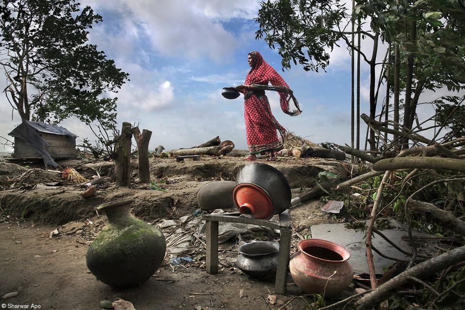 A woman after a devastating natural disaster in Bangladesh.