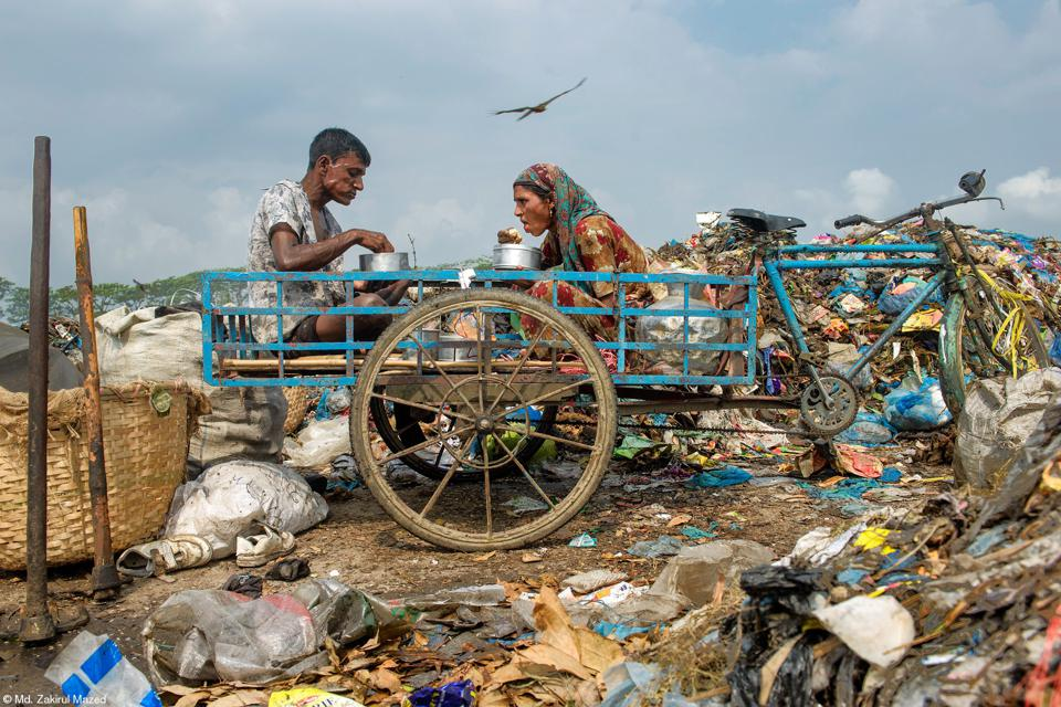 A couple working in a garbage field in Bangladesh.
