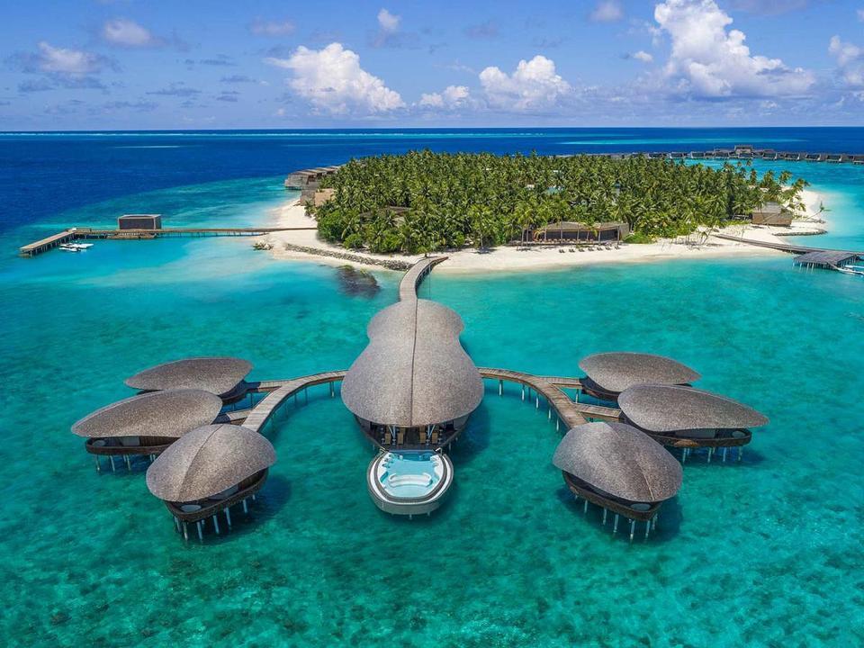 The St. Regis Maldives Vommuli Resort Iridium Spa with Blue Hole pool