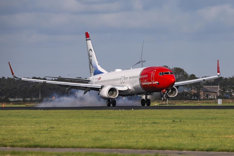 Norwegian Air Boeing 737 Landing At Amsterdam Schiphol Airport.