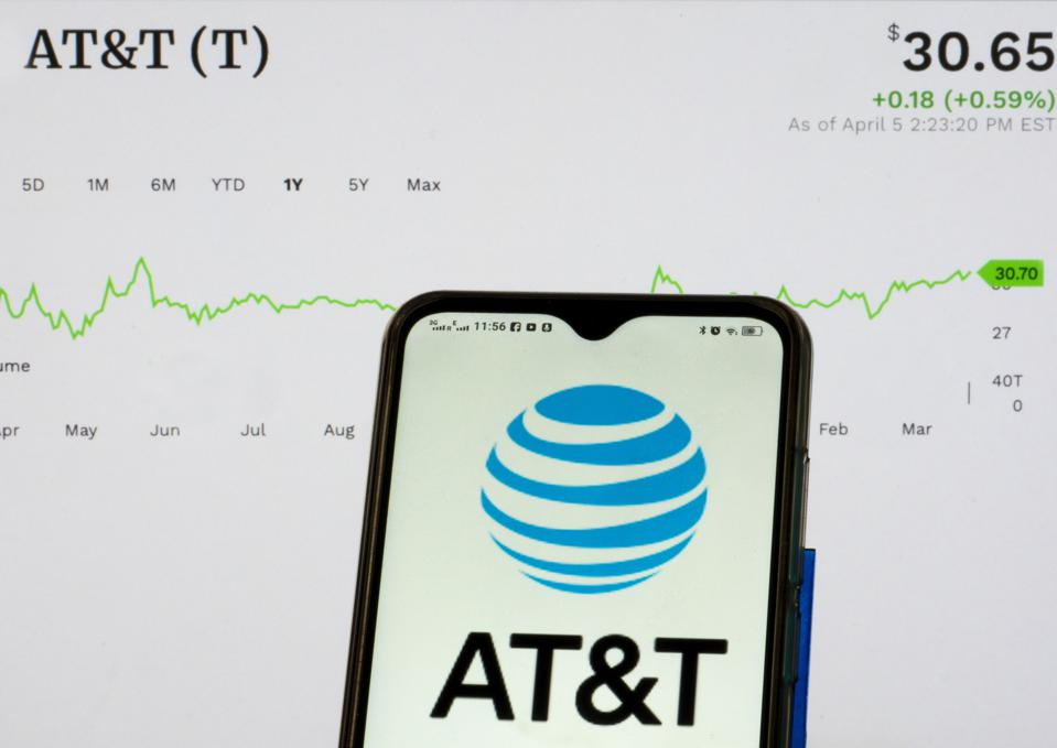 In this photo illustration, an AT&T logo seen displayed on a...