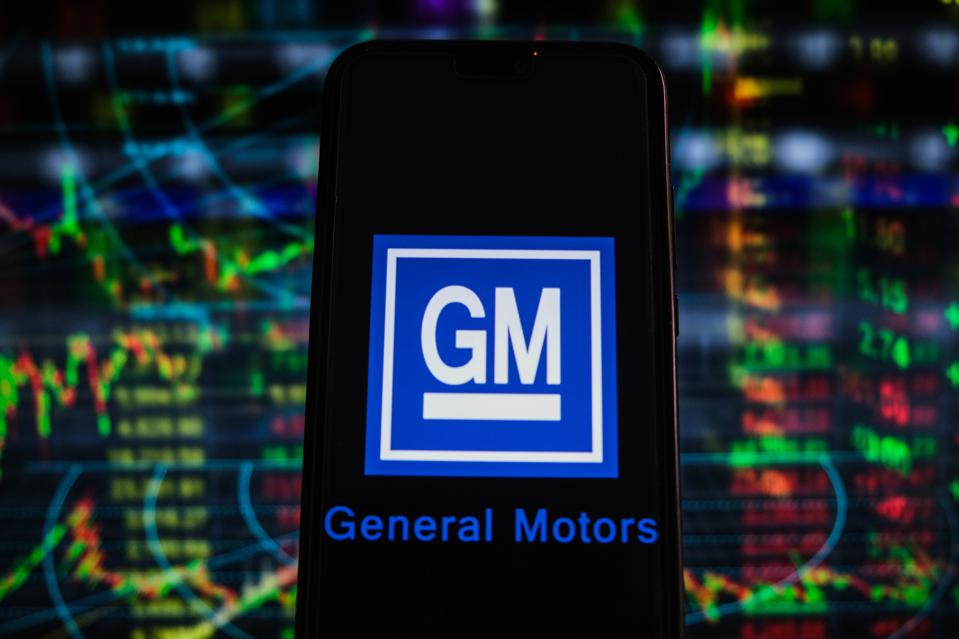 In this photo illustration a General Motors logo seen...