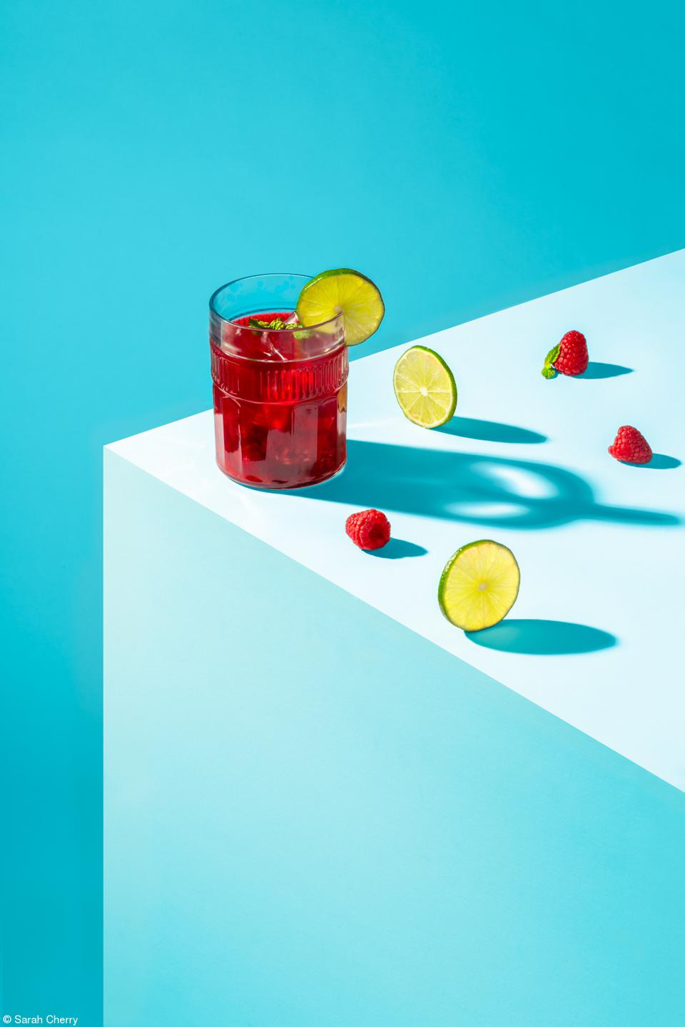 Raspberries and Limes in a colorful, conceptual photo.