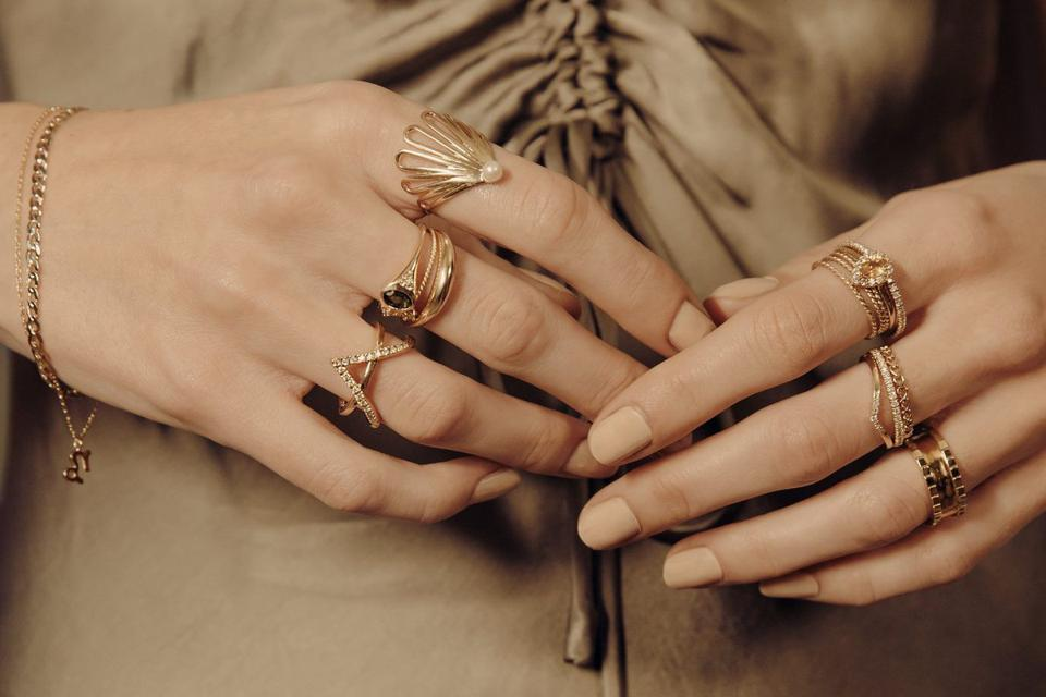 Woman's hands with several rings, including Vintage Oval Cut Ring from Curate