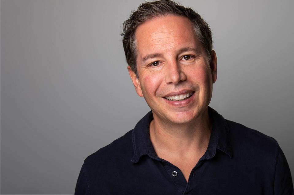A headshot of Karl Jacob the cofounder and CEO of LoanSnap.