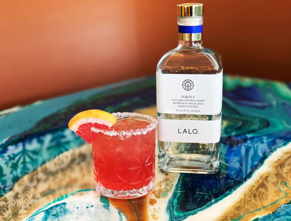 Bottle of LALO tequila and cocktail glass