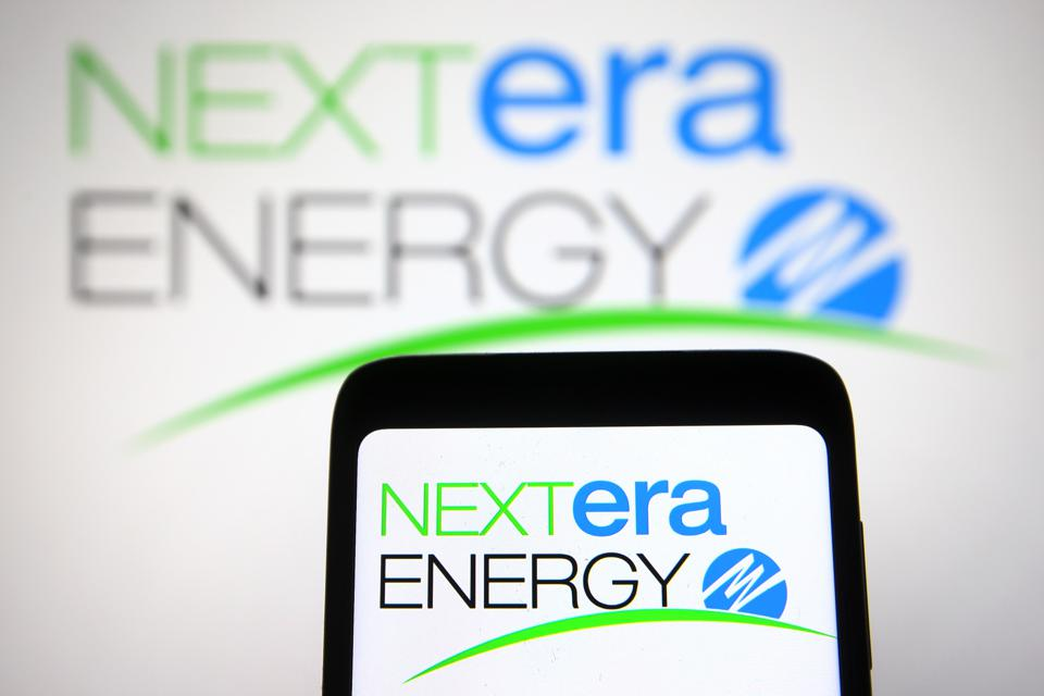 In this photo illustration, the NextEra Energy logo of an US...