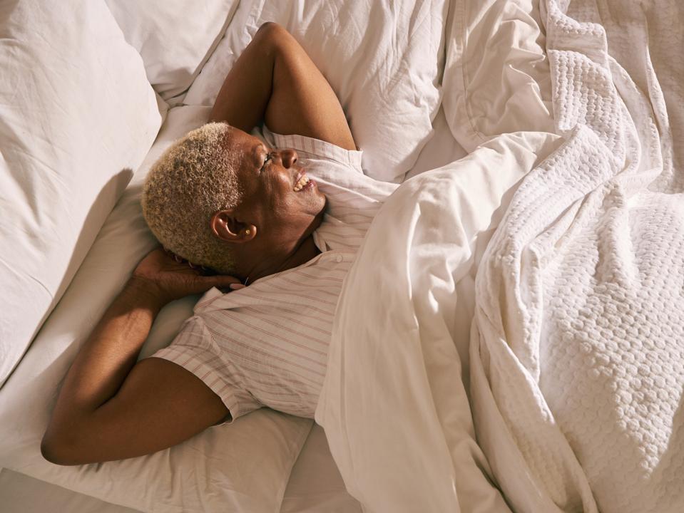 Woman in bed - Tatch Sleep Kit