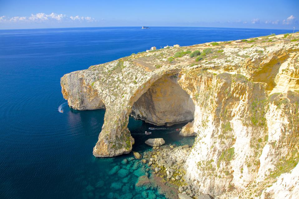 The Blue Grotto, on the southeast coast of Malta–now considered safe for non-essential travel by the U.K. government.