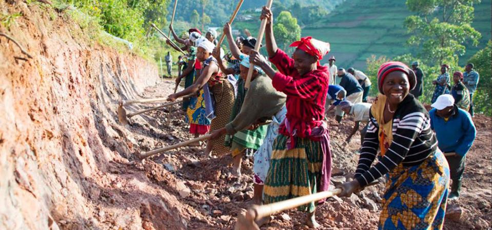 Community members in last-mile village constructing road to connect them to local markets