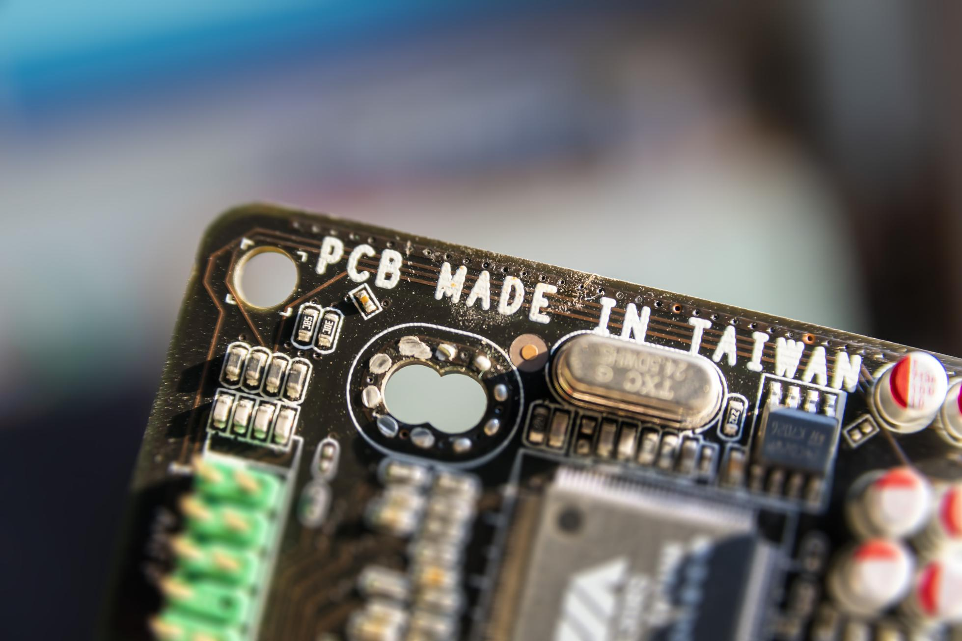 Manufacturing concept. Close up computer mother board.