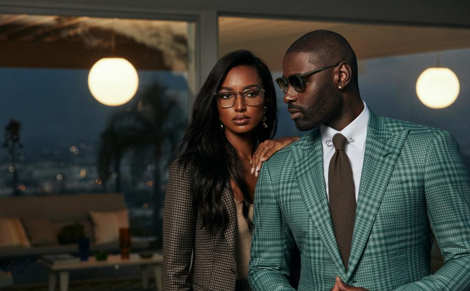 two models wearing suits and sunglasses