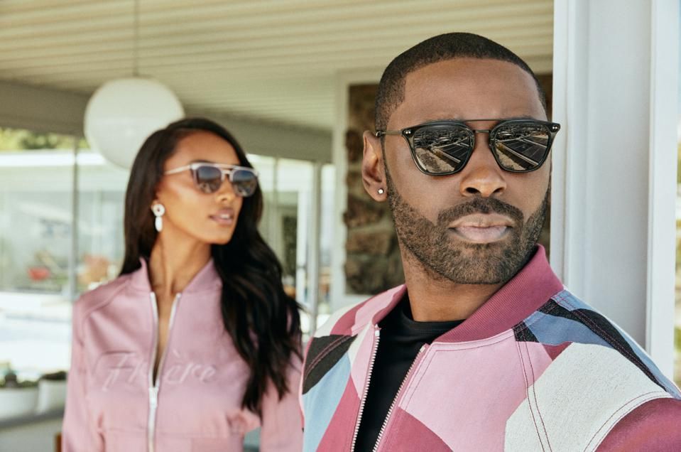 models wearing matching pink outfits and sunglasses