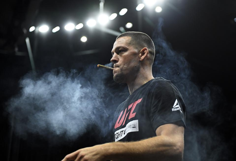 UFC fighter and cannabis activist Nate Diaz puffs a CBD joint during an open workout for fans and media at Honda Center on August 14, 2019 in Anaheim, California.