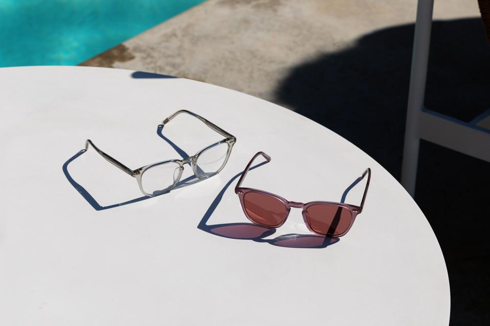Two pairs of sunglasses on a table