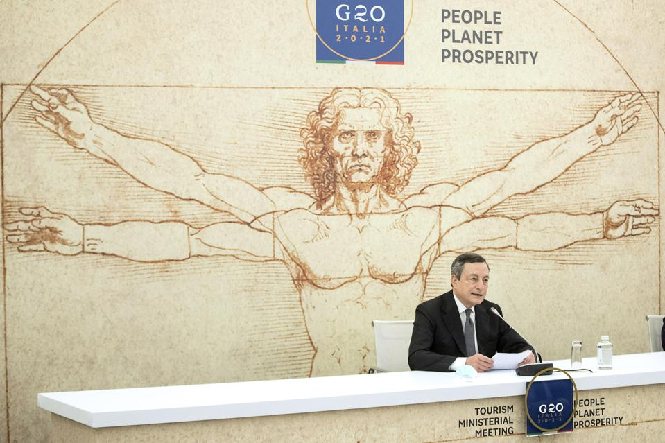 Italian Prime Minister Mario Draghi addresses the G20 meeting in Rome, Tuesday May 4, 2021