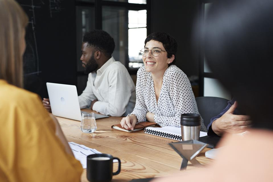 Smiling businesswoman in meeting at workplace