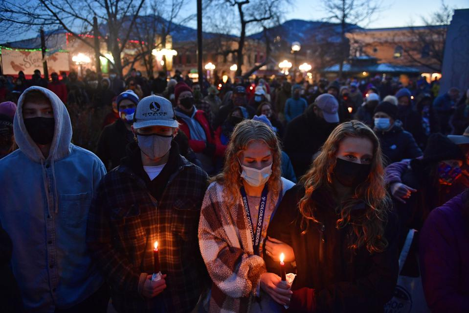 Candlelight vigil for 10 victims of mass shooting