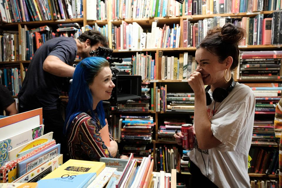 Kelly Oxford and Jessica Barden laugh behind the scenes filming Pink Skies Ahead.