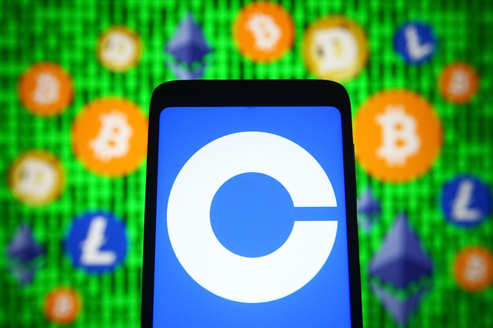 In this photo illustration, Coinbase logo of a...