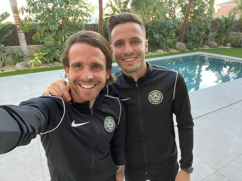 Professional soccer players and brothers Aarón Ñíguez (left) and Saúl Ñíguez (right).