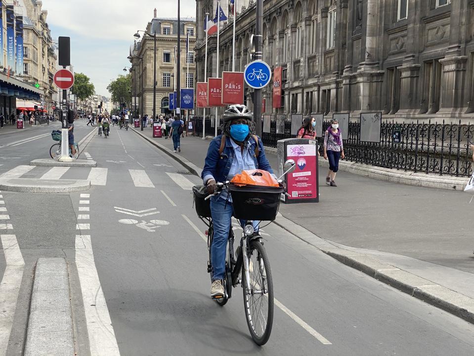 woman cyclist on Rue de Rivoli, Paris