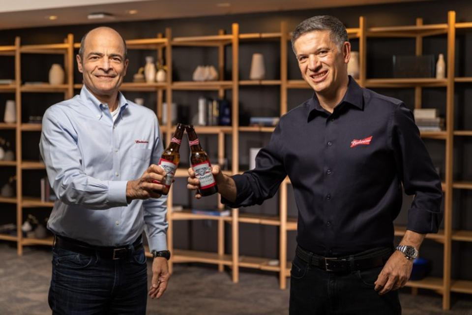 Departing CEO Hector Brito (left) and his replacement Michel Doukeris (right) toast a strong start to 2021.