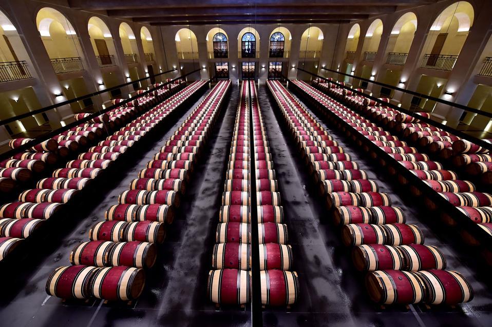 Château Montrose cellar room with barrels
