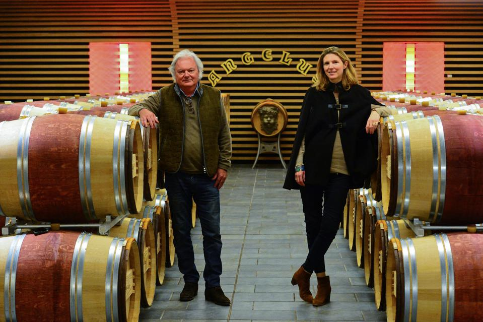 Owners of Château Angelus in cellar