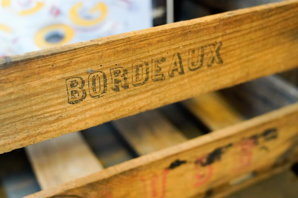 Bordeaux ancient text sign on wooden wine crate old vintage for bottles