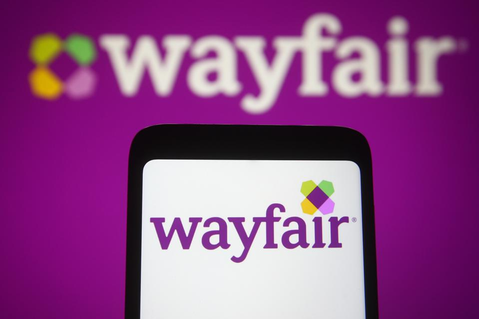 In this photo illustration, the Wayfair logo of the US e-...