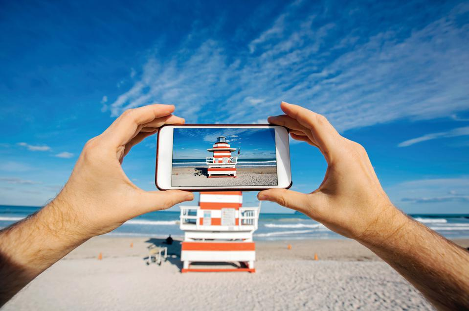 Taking pictures with smartphone at Miami Beach, personal perspective view