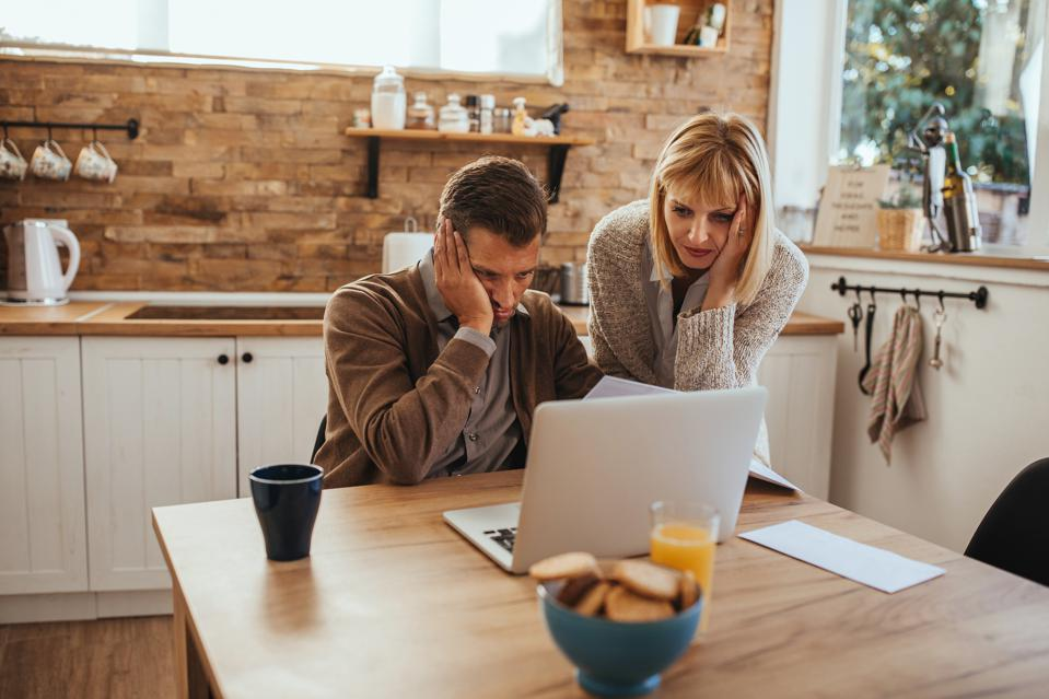 Worried couple working on a budget