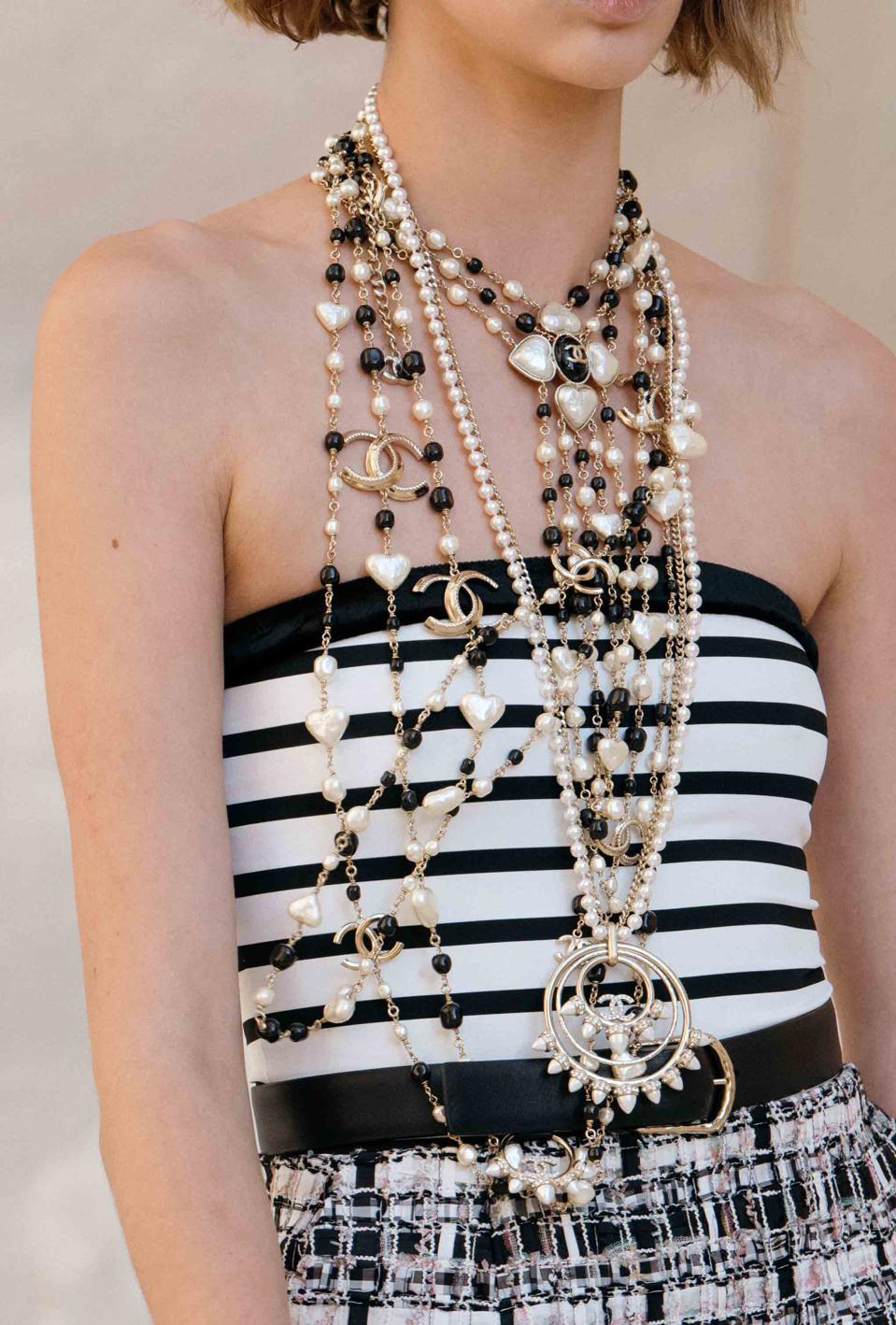 Layers of black and white, layers of chains, long necklaces